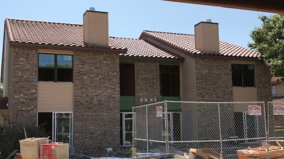 Classic Construction condo fire restoration project, new windows, roof and doors have been replaced.