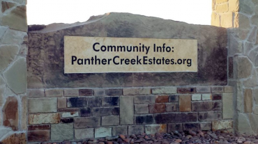 broken Panther Creek monument sign