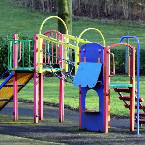 playground slide and stairs with various primary colors