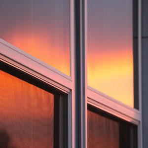 Photo of window with 4 window panes and the sunset is hitting them directly