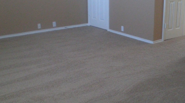 A repaired room with fresh paint and carpet
