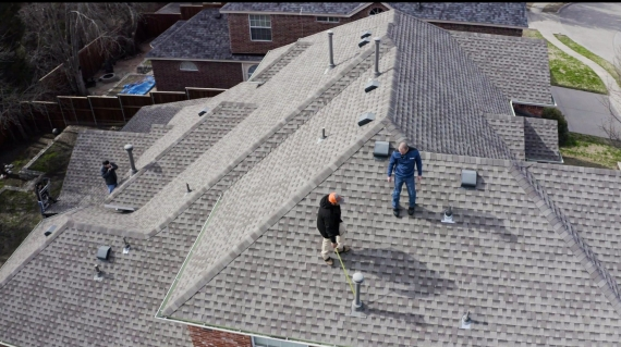 two GAF Certified quality roofing contractors on the roof taken from arial view of the roof