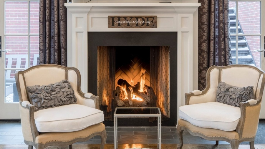 stylish white living room area with fireplace