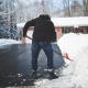 shoveling snow on iced driveway