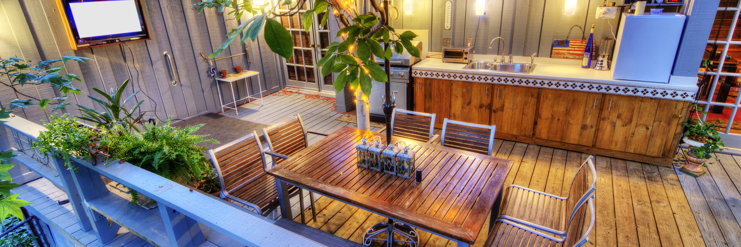 Luxury deck with seating, grills, and plants