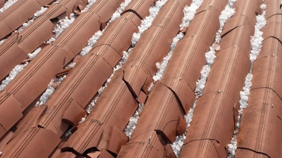 cracked Spanish tile roof with hail damage