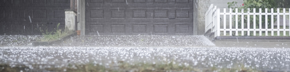 hailstorm in front of a house
