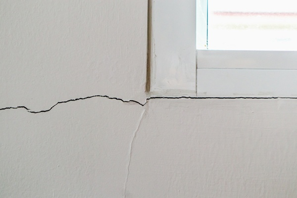 cracks around windows indicate foundation damage