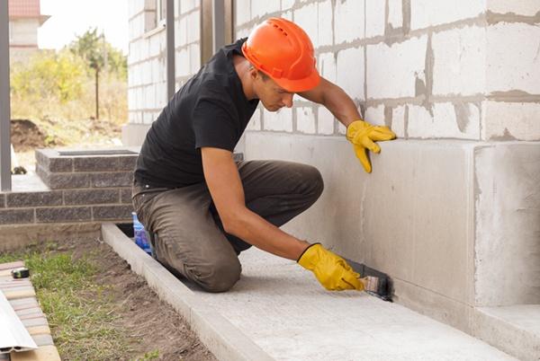 construction working repairing foundation