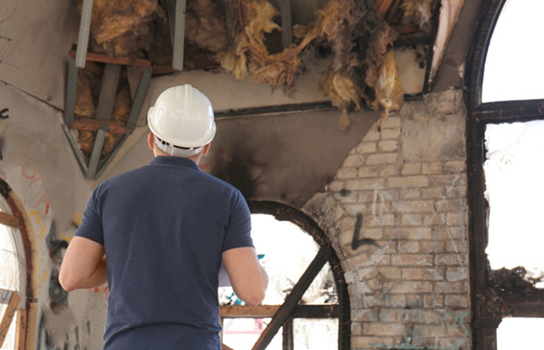 Insurance adjuster inspecting a building