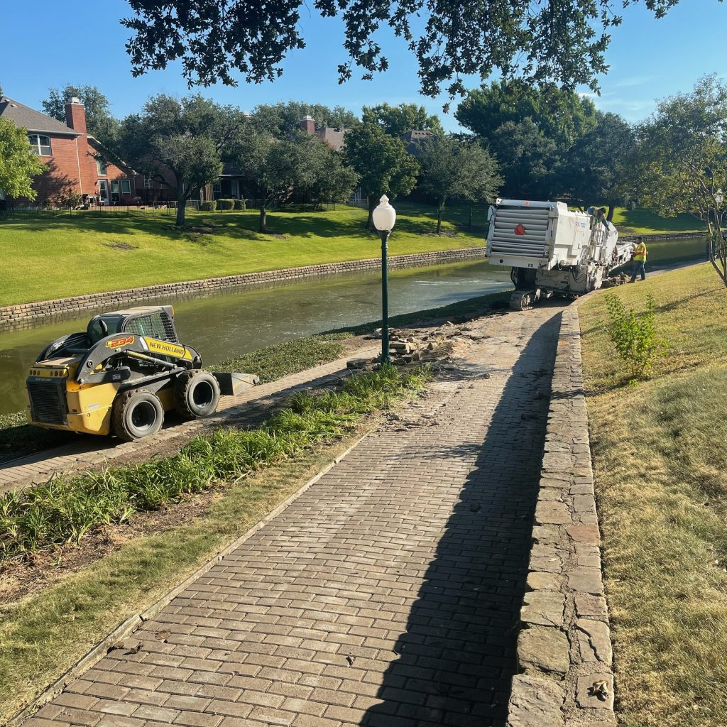 Demolition of the old concrete pathway