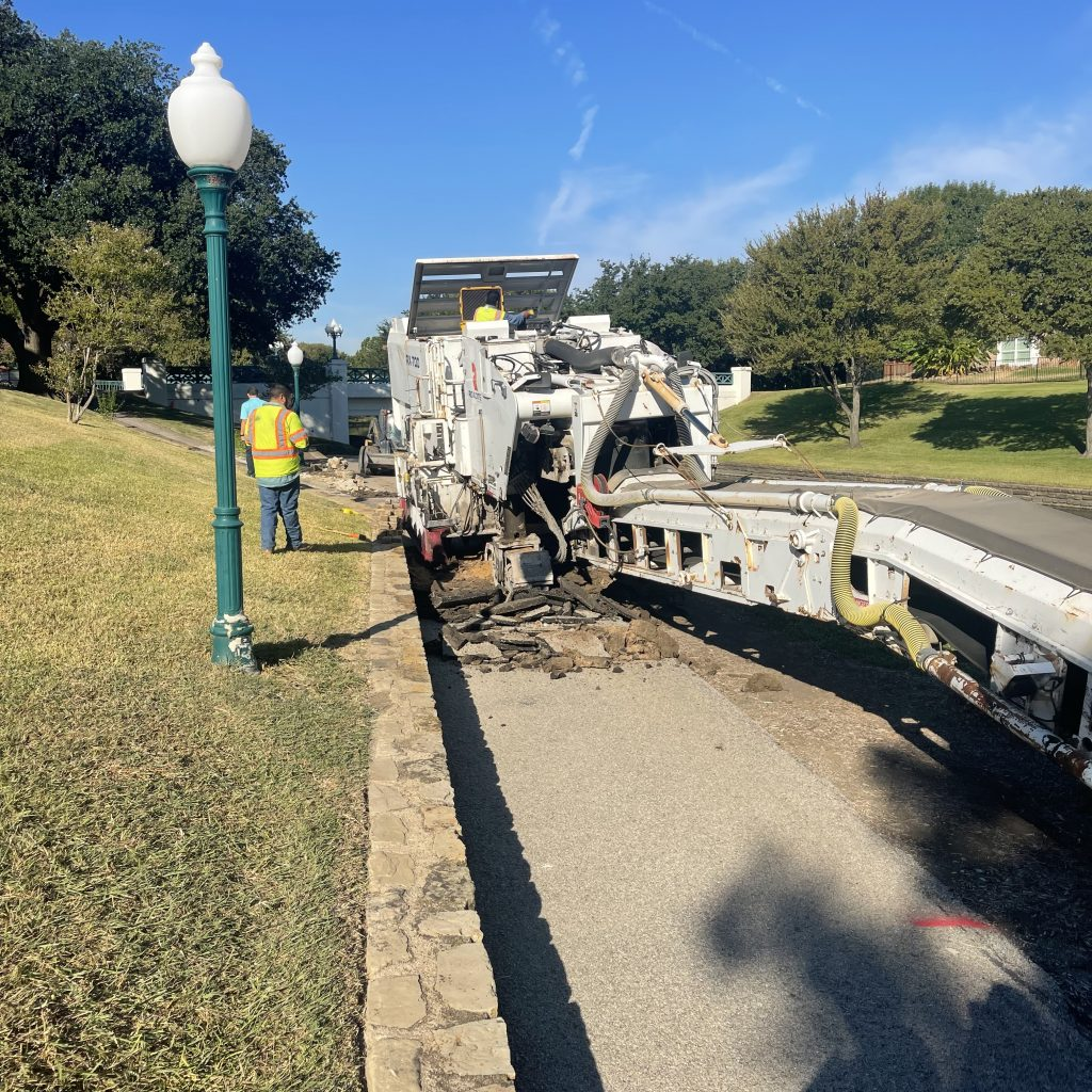 Starting demolition of the old concrete pathway